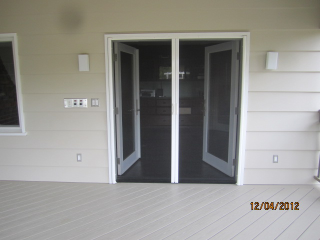 Exterior view of a double set of open retractable screen for Double open french doors