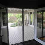 Interior View of a Double Set of Open Retractable Screen Doors installed on French Doors in Office in Point Dume, Malibu