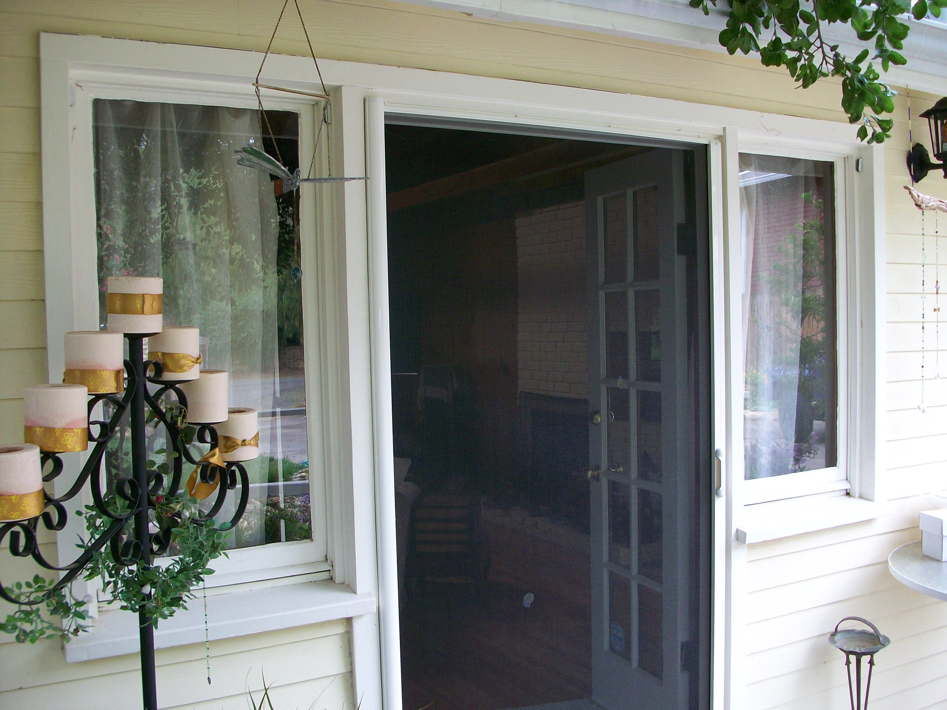 Retracting door our outdoor retractable screen doors are for Retractable double screen door