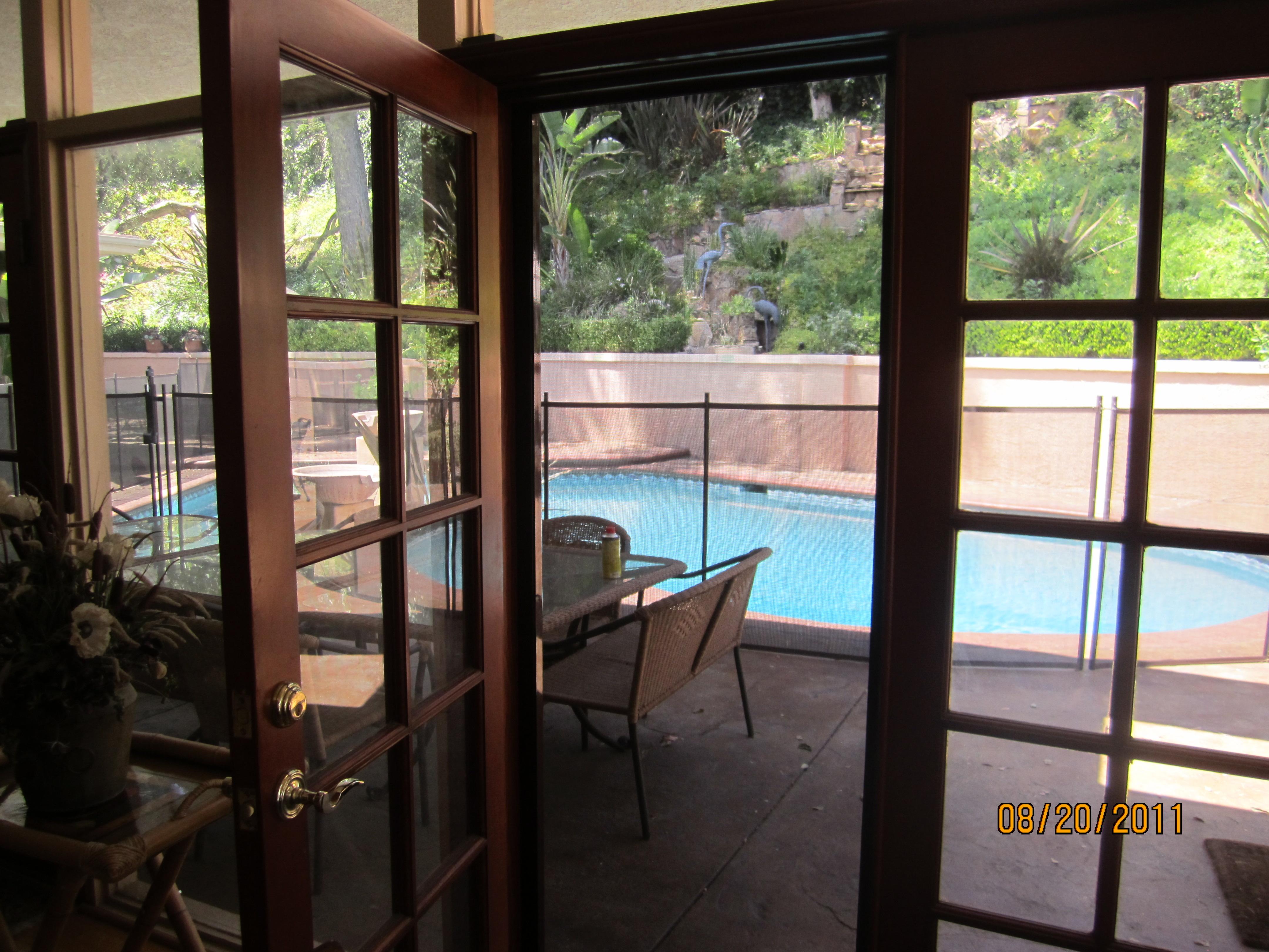 Patio screen doors licensed contractor custom screens for Roll away screens for patio doors
