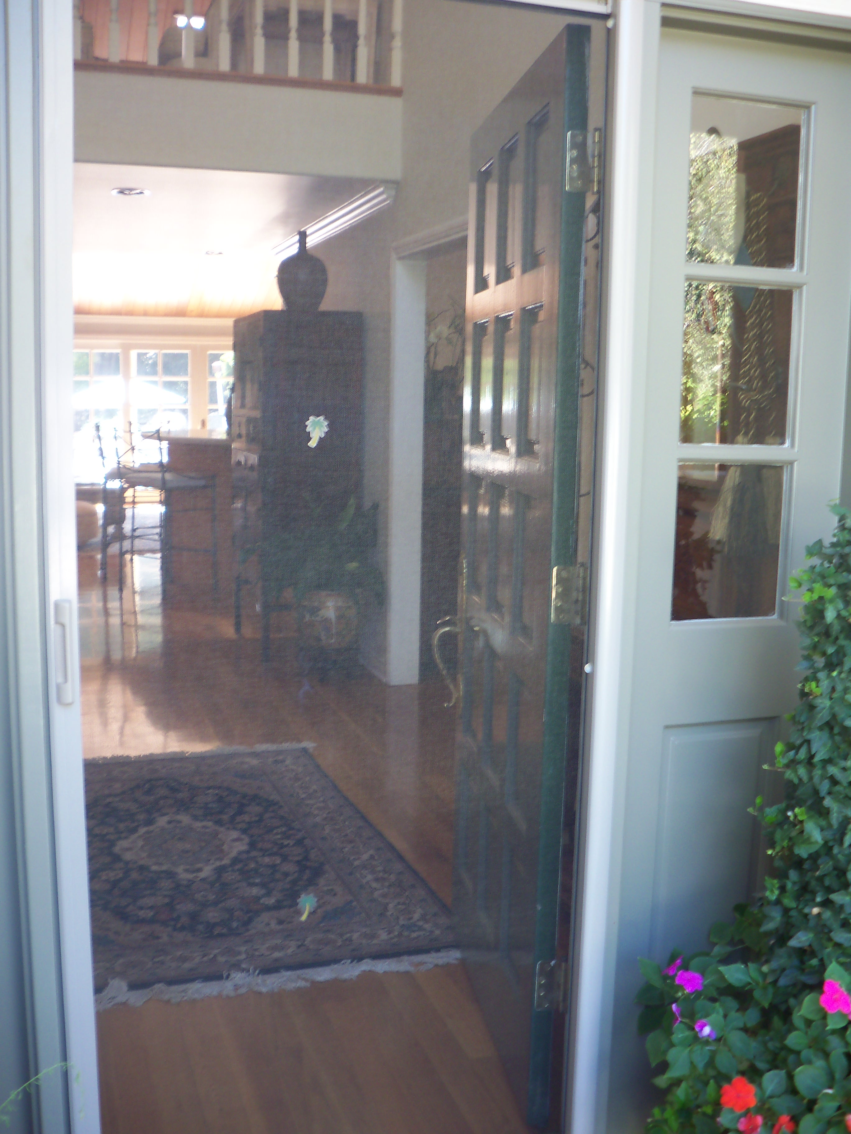 Screen door licensed contractor custom screens for Hidden sliding screen door