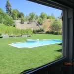 Large window panel overlooking pool