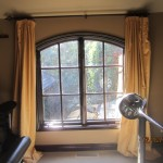 Screen arched panel installation in music room