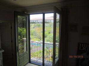 Closed set of retractable screen doors in Topanga