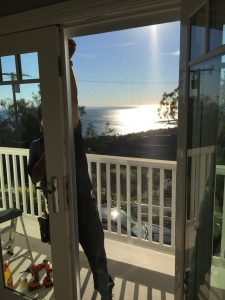 Malibu home arched window screen replacement balcony ocean view